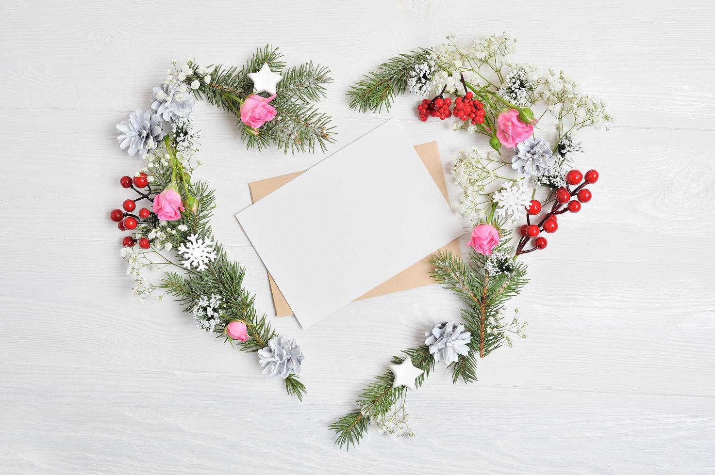 Mockup of heart-shaped wreath with blank paper. photo