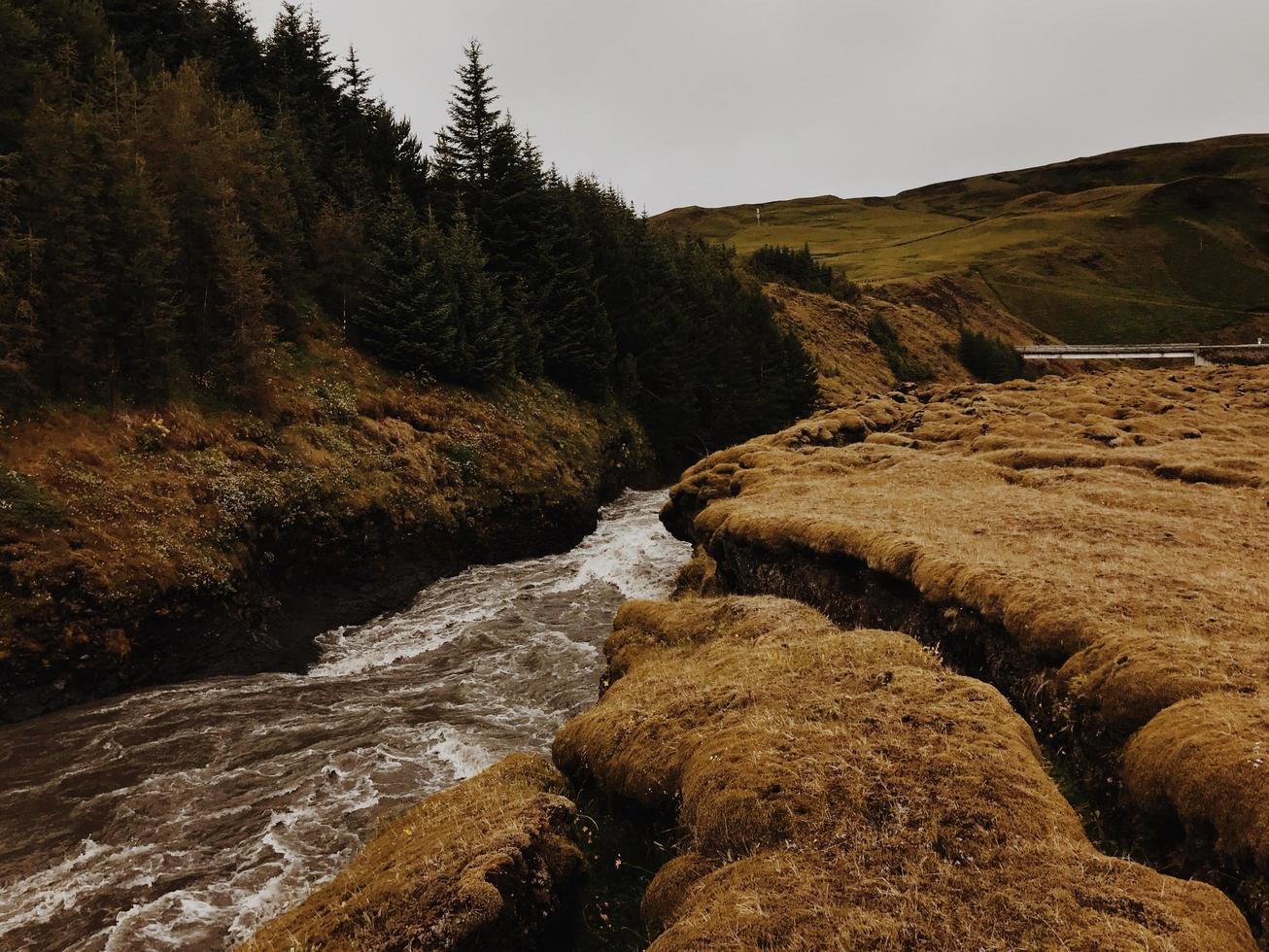 Water stream between rocks photo