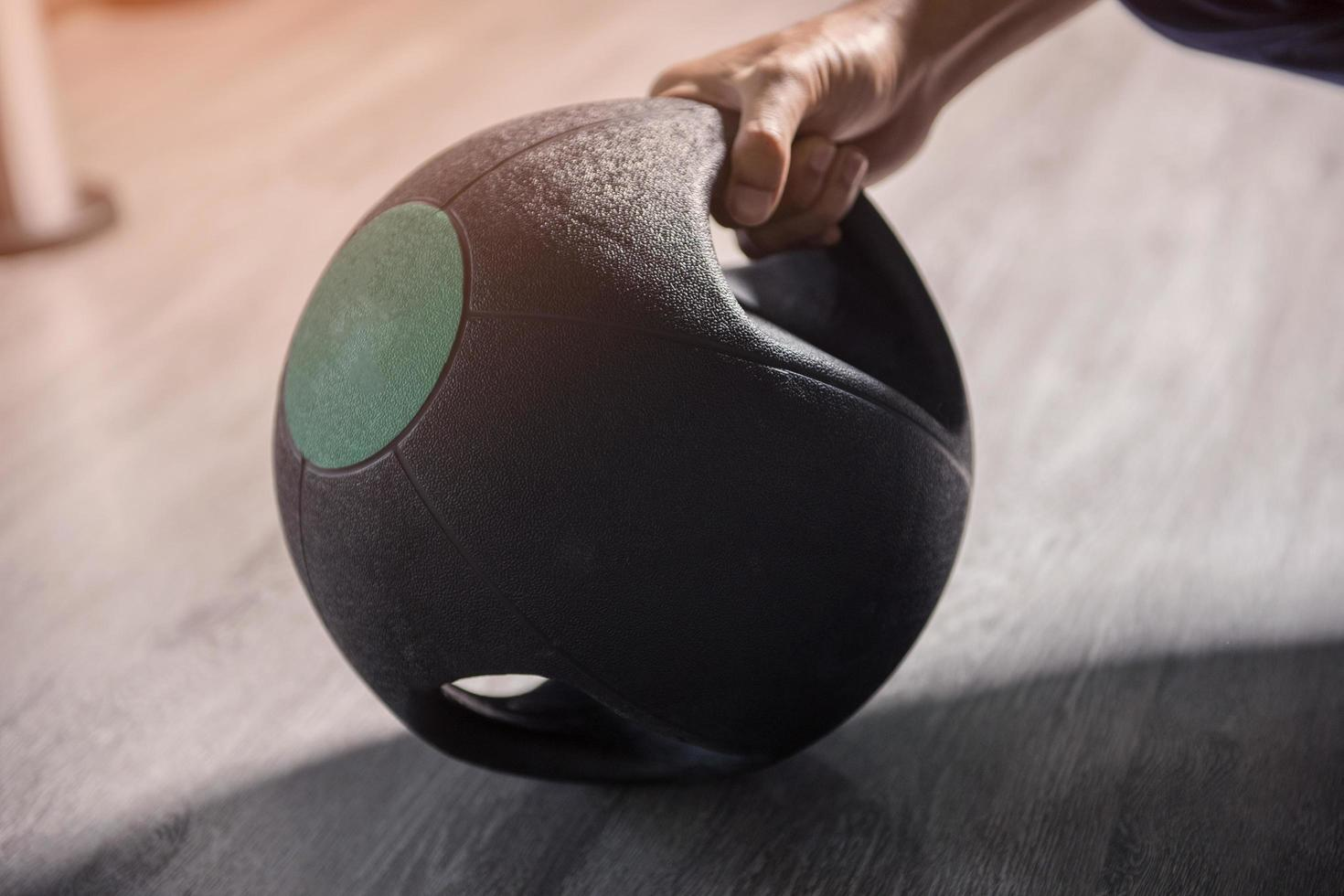Closeup of hand holding weight in a gym photo