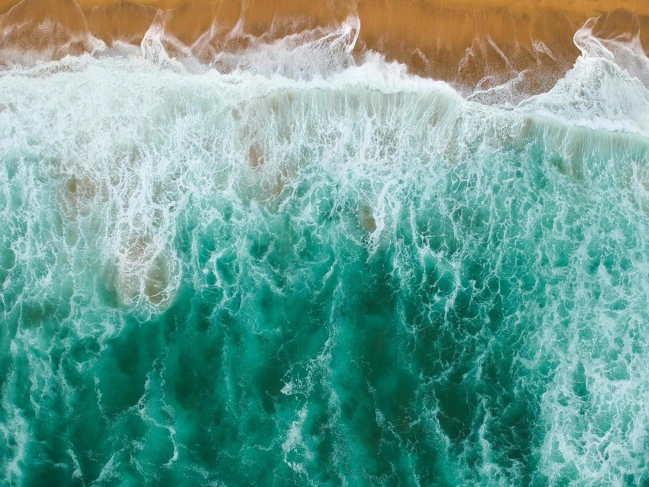 Waves crash shore photo