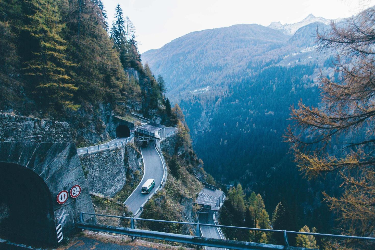Concrete tunnel on winding mountain road photo