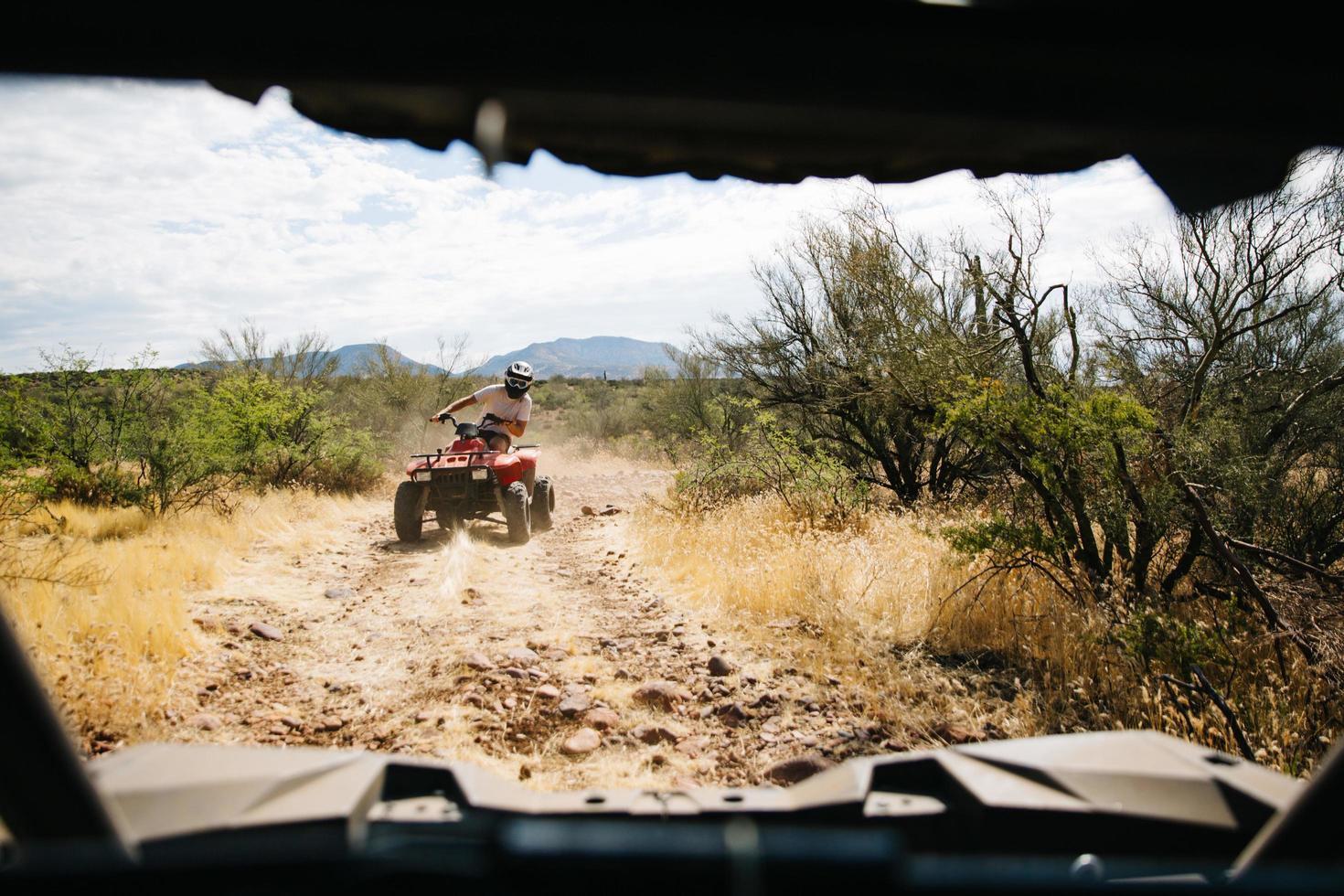 Quad riding in desert photo