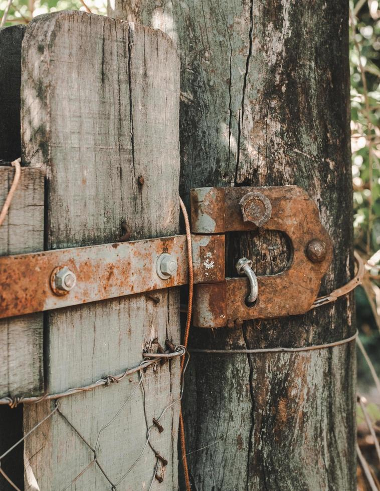 Brown wooden fence with padlock photo