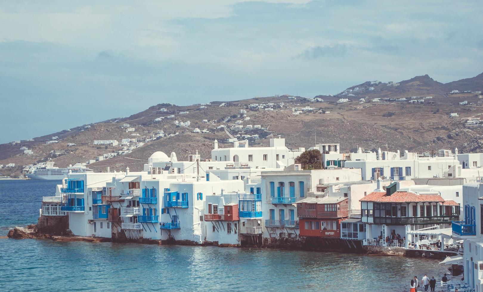 Waterfront homes next to mountain photo