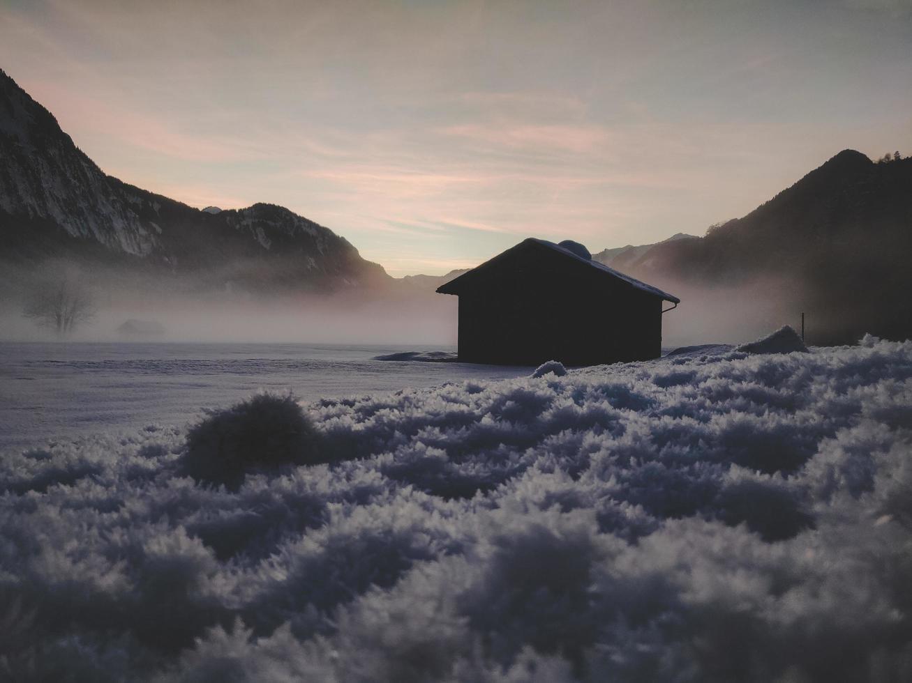 Silhouette of house near mountains photo