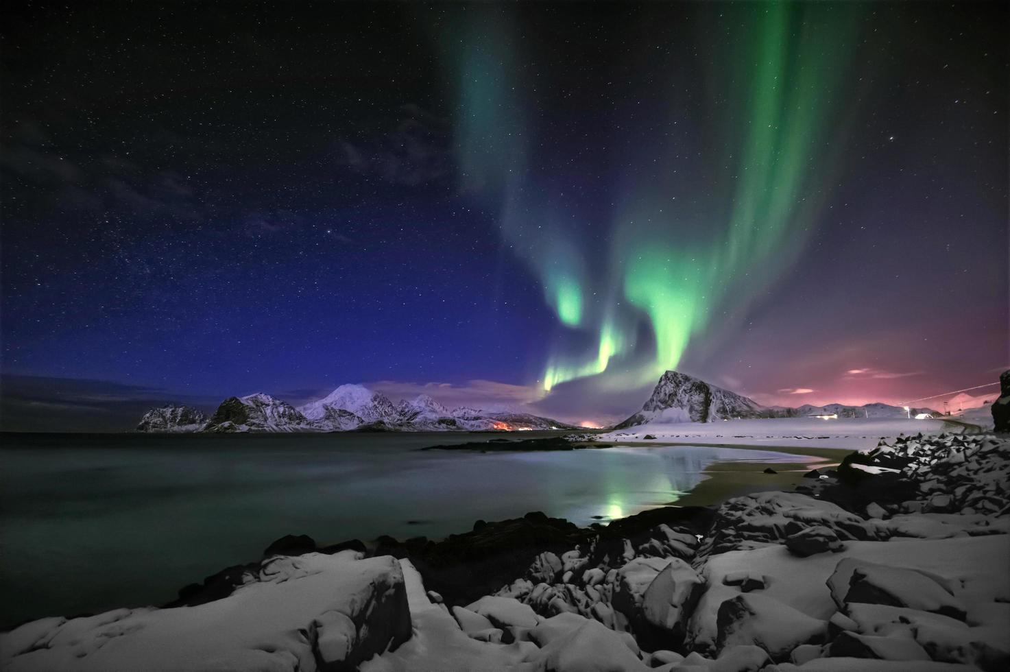 Northern lights above a beach at Stor Sandnes in Flakstad Municipality photo