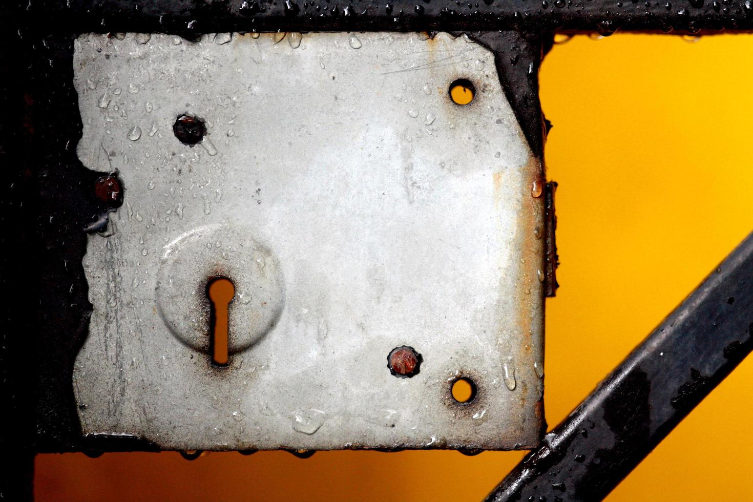 Close up view of a metal keyhole and lock photo