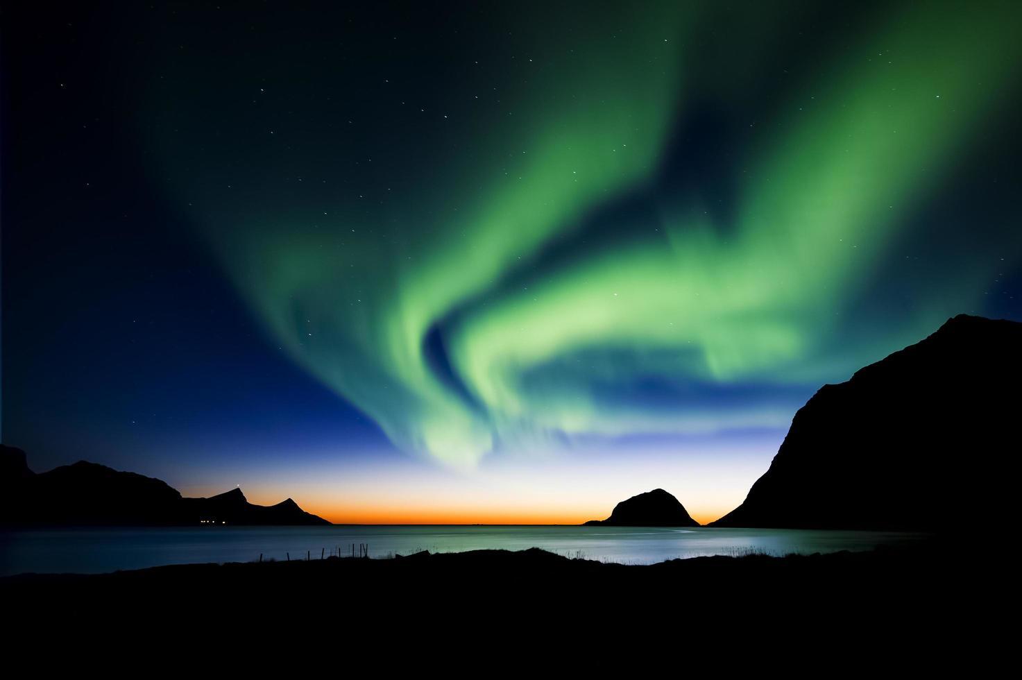 Aurora borealis on night sky photo