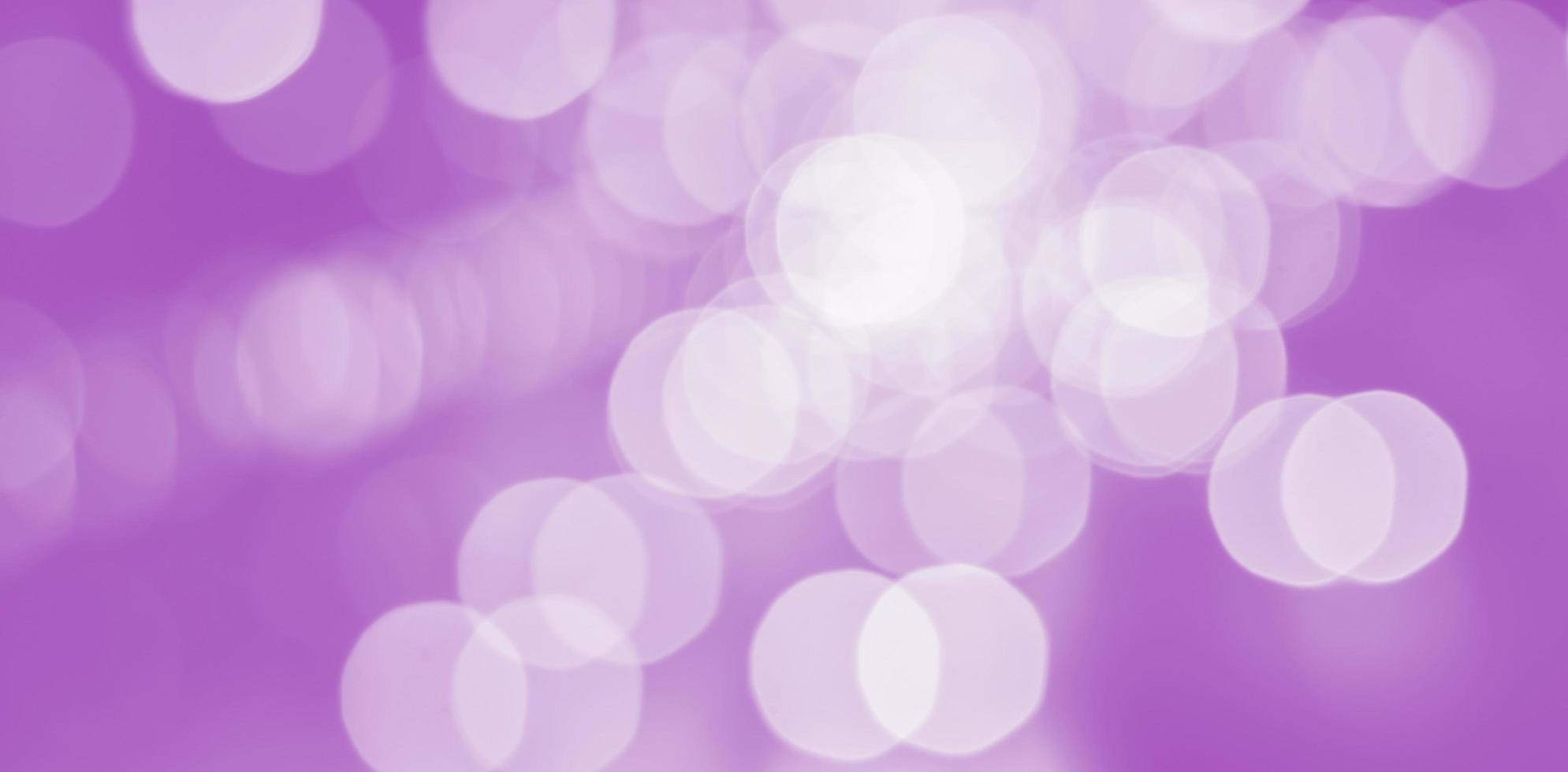 Abstract bokeh on pink background photo