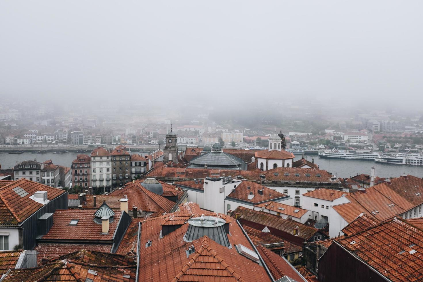 Aerial view of city in fog photo