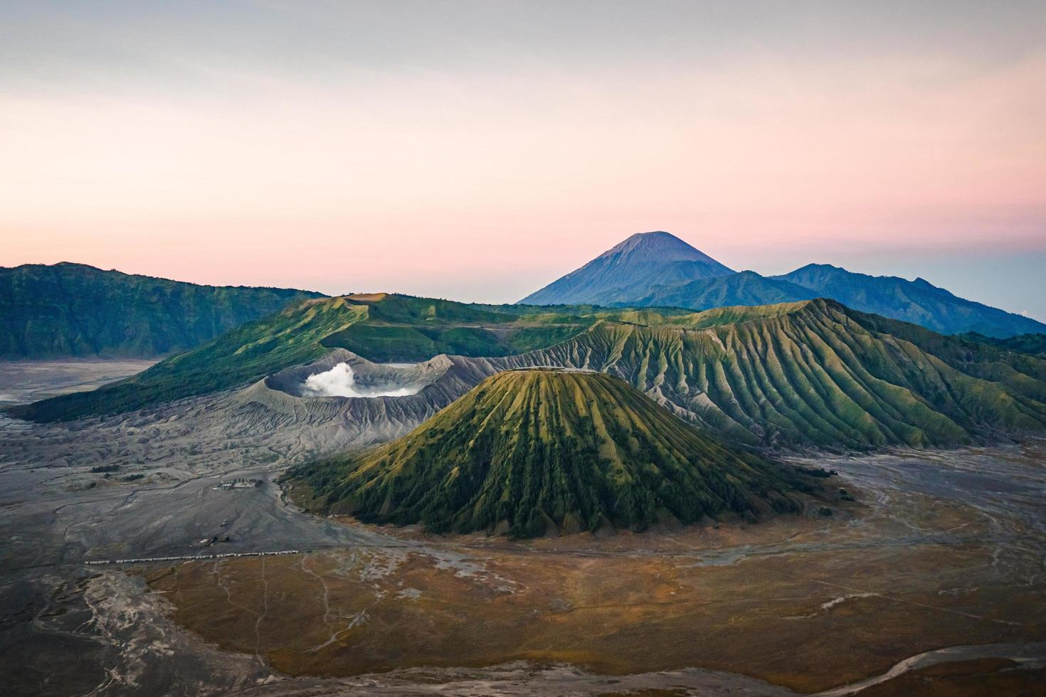 View of volcano at sunset photo