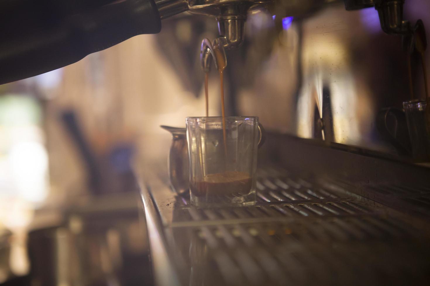 Coffee maker pouring espresso photo