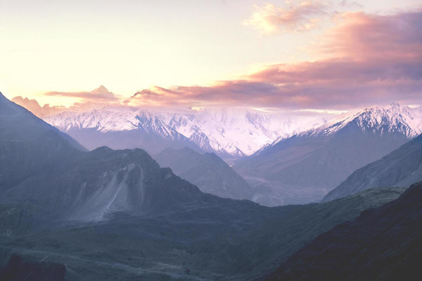 Sunrise over snow capped Karakoram Mountain range photo