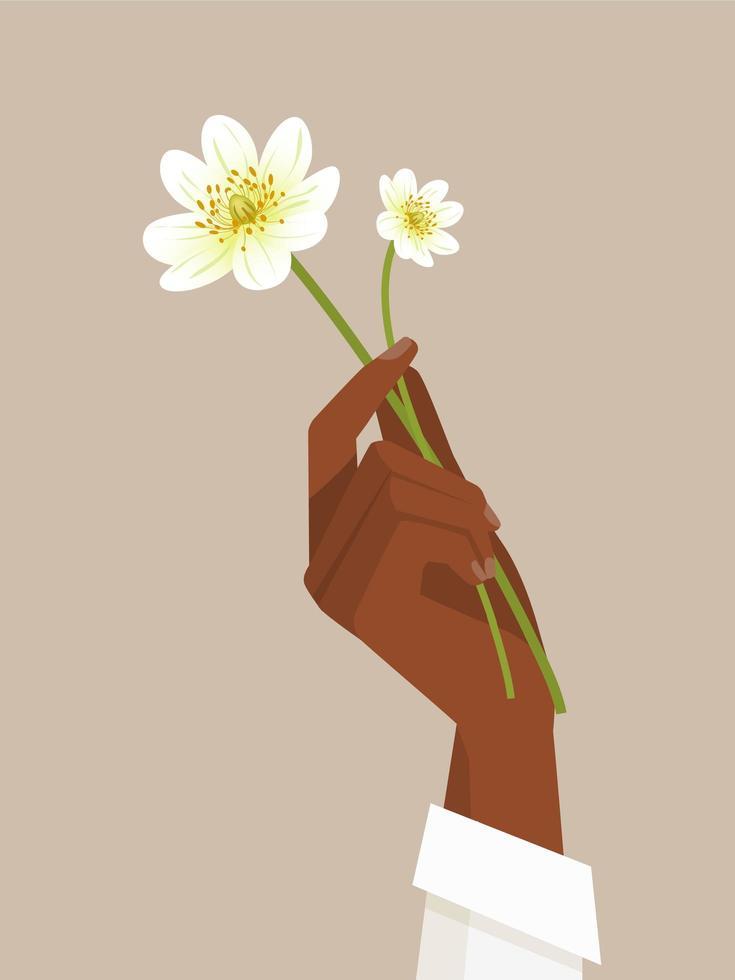 mano femenina negra que sostiene las flores vector