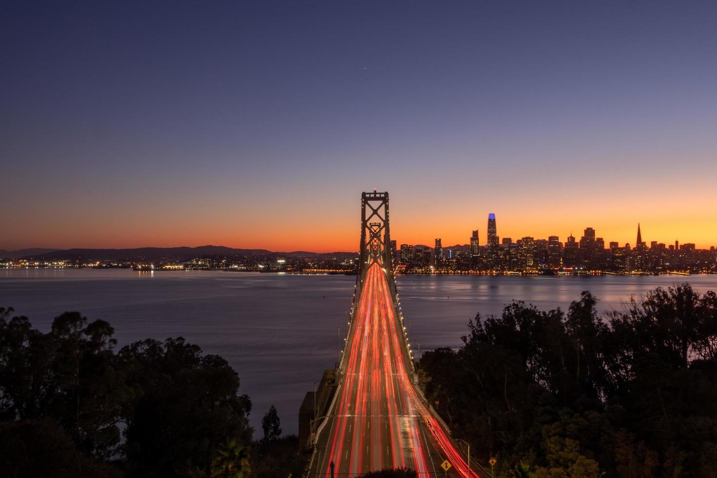 Bridge over water at night photo