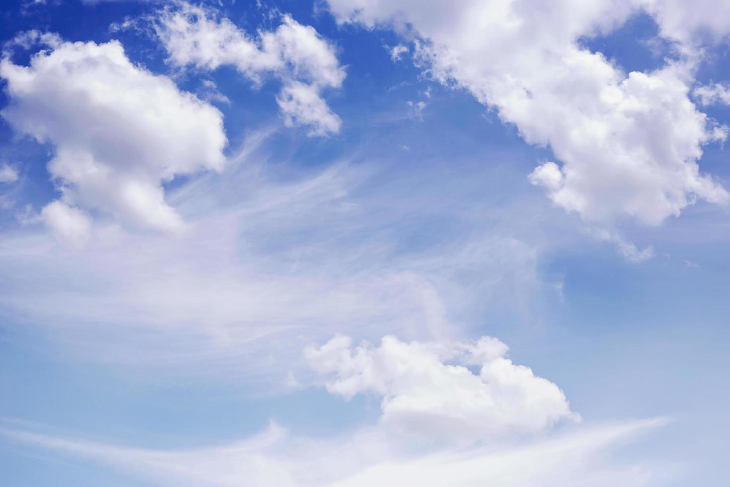 White clouds on blue sky photo