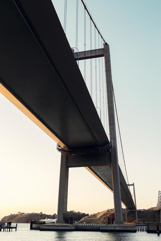 Concrete bridge at sunset photo