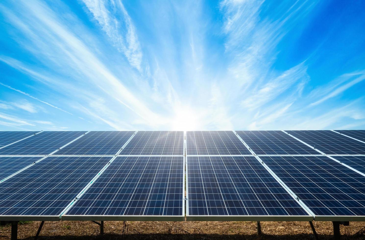 Solar panel on blue sky background photo