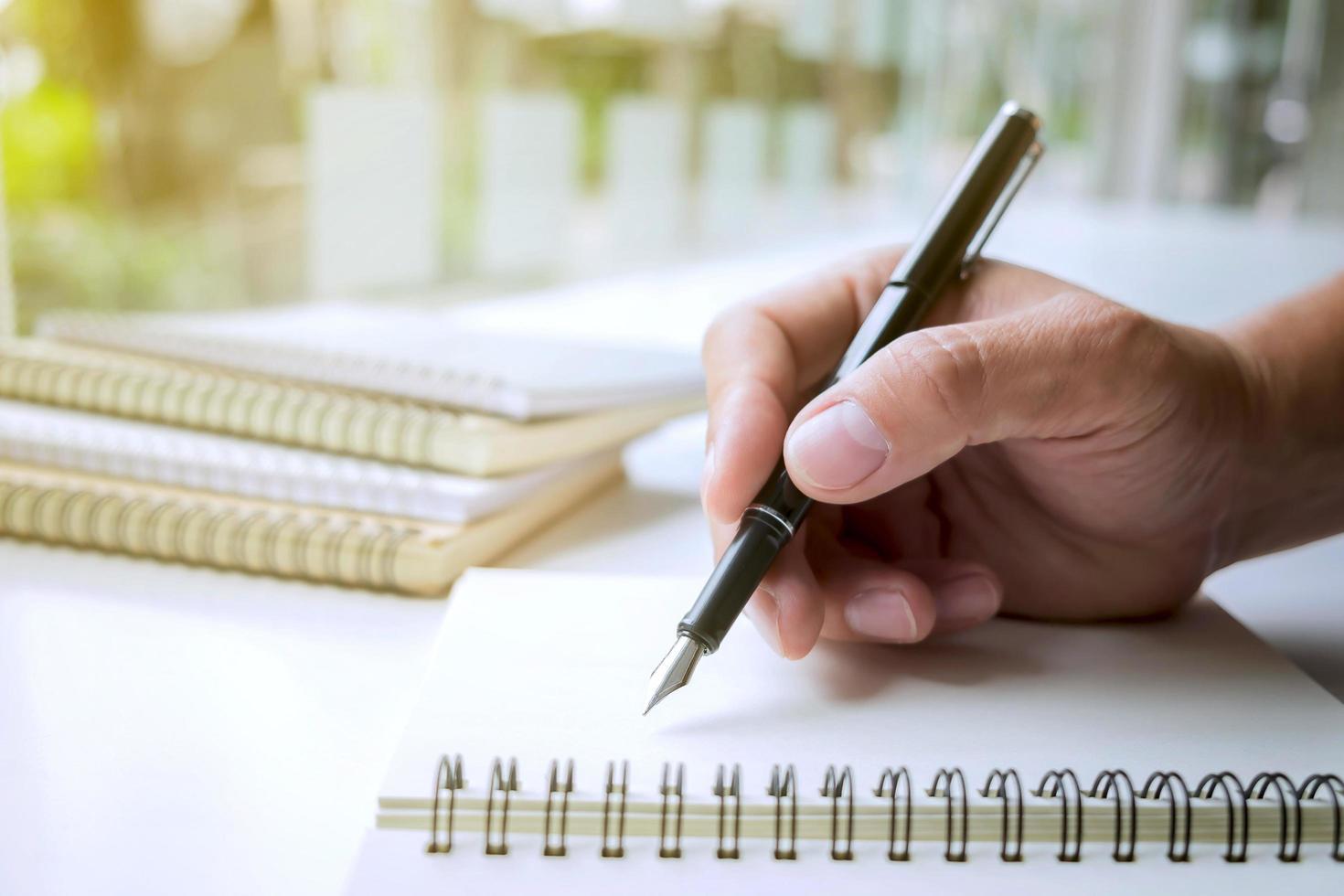 Close up human hand writing photo
