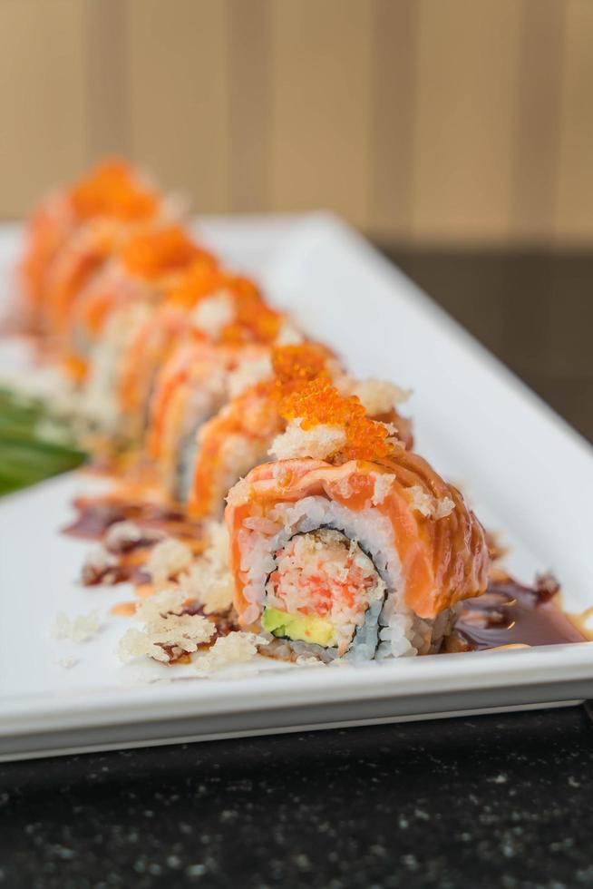 Salmon sushi rolls on a plate photo