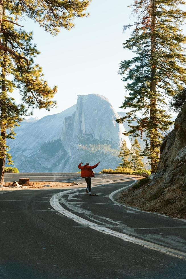 Man skateboarding in front of Half Dome photo
