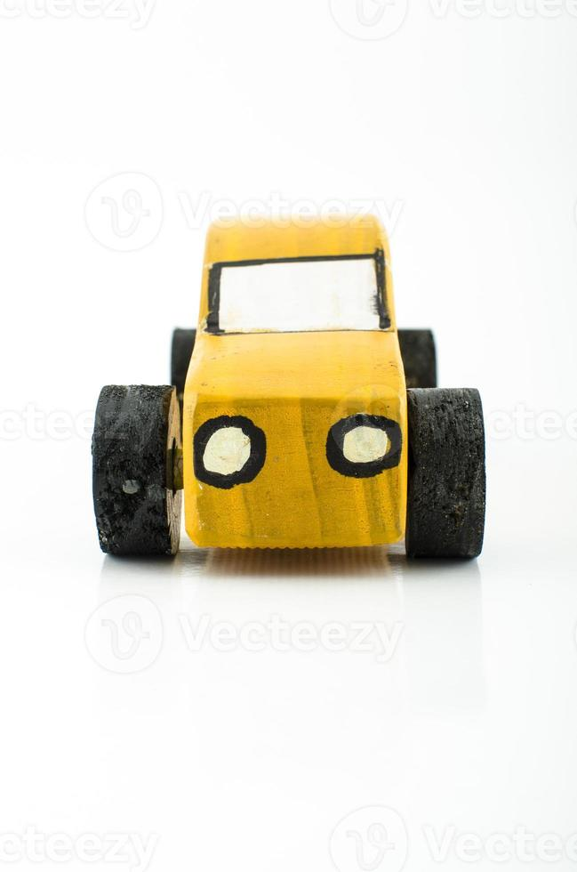 Old yellow wooden toy car photo