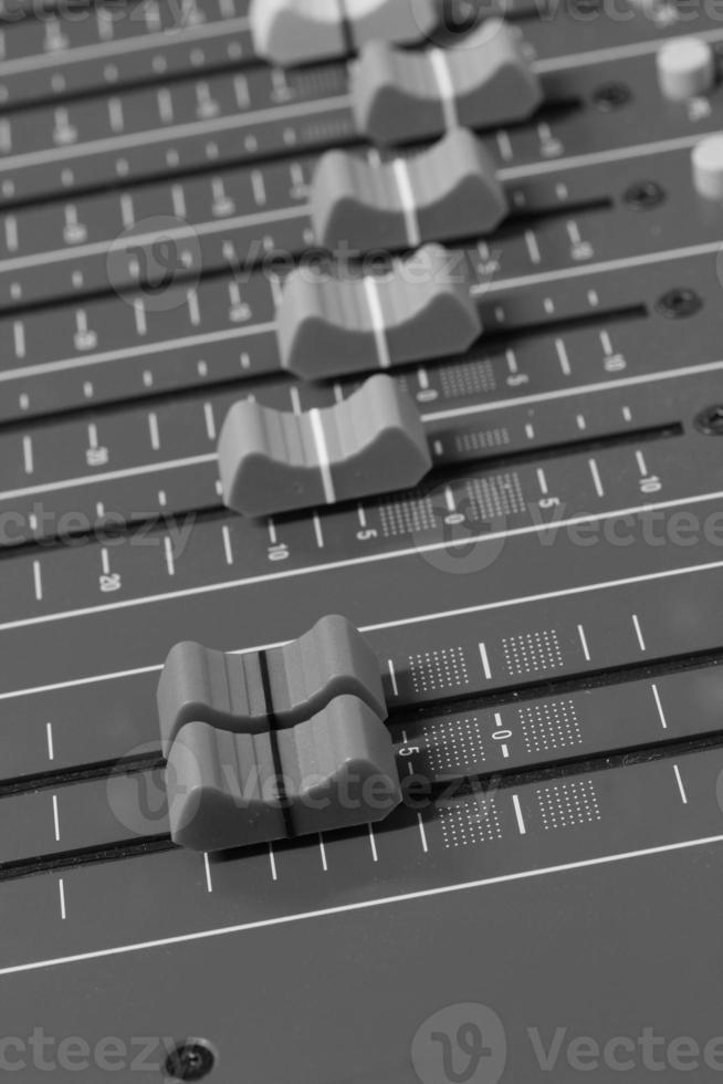 Black and white audio mixer panel close photo