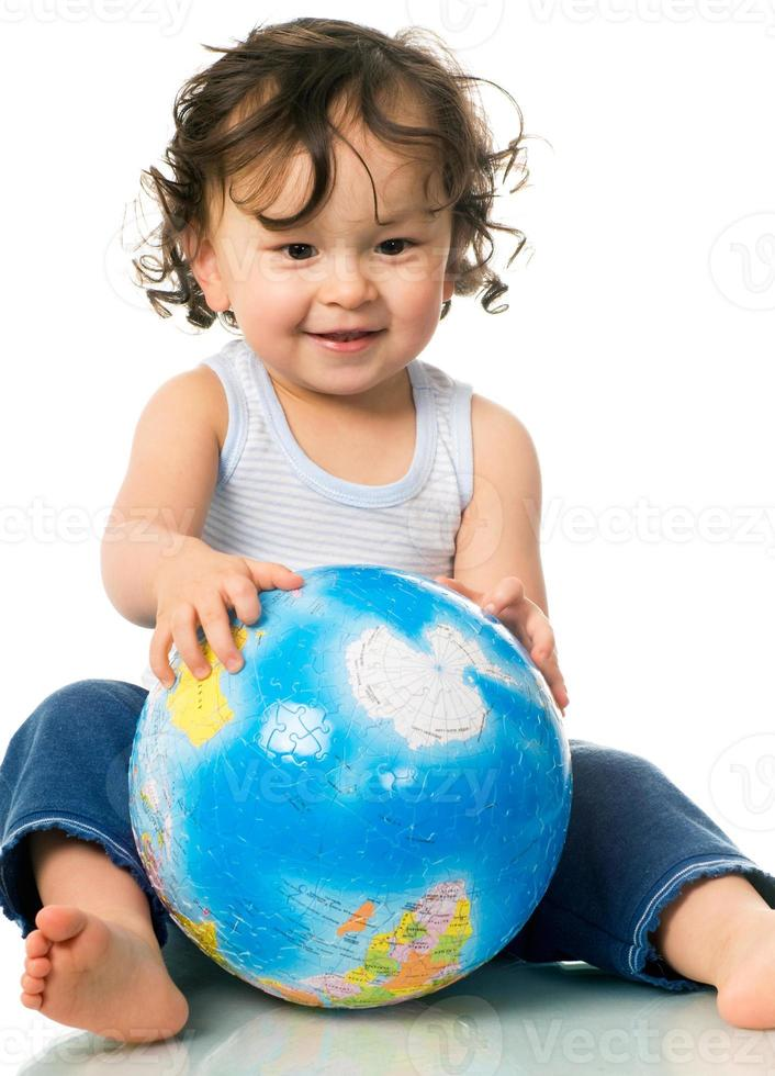 Baby with globe puzzle. photo