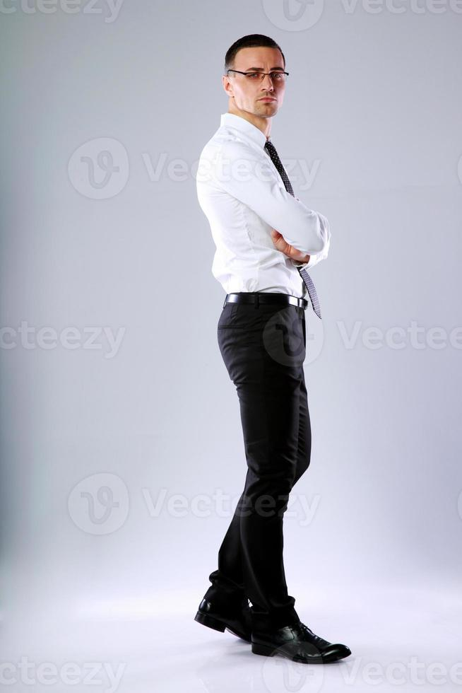 confident businessman with arms folded photo