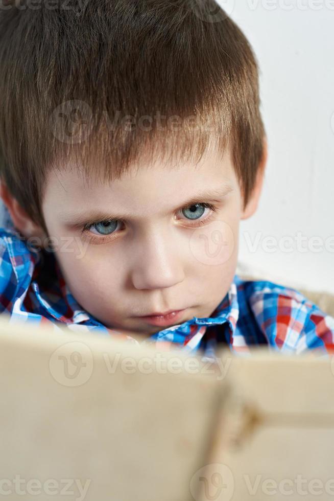 Little boy reading book photo