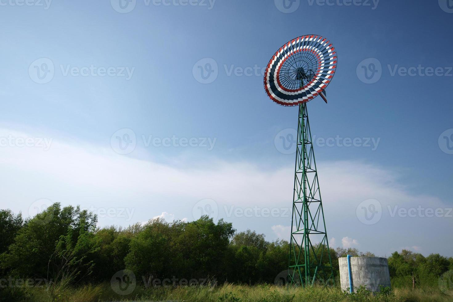 Windmill at the farm in Thailand photo