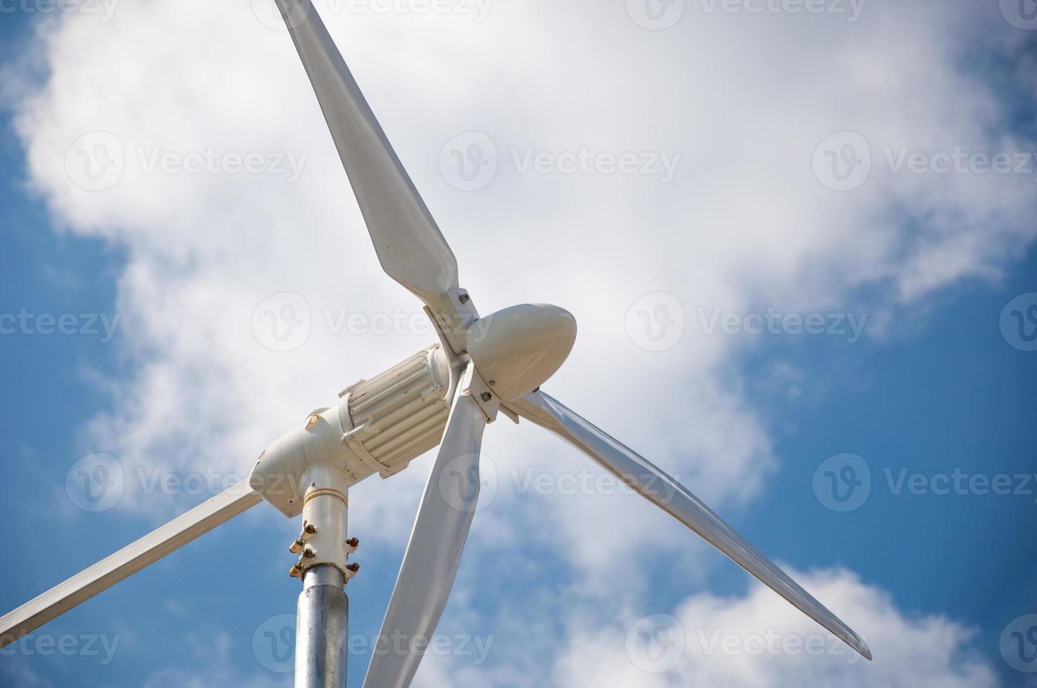 Closeup of wind turbine producing alternative energy photo