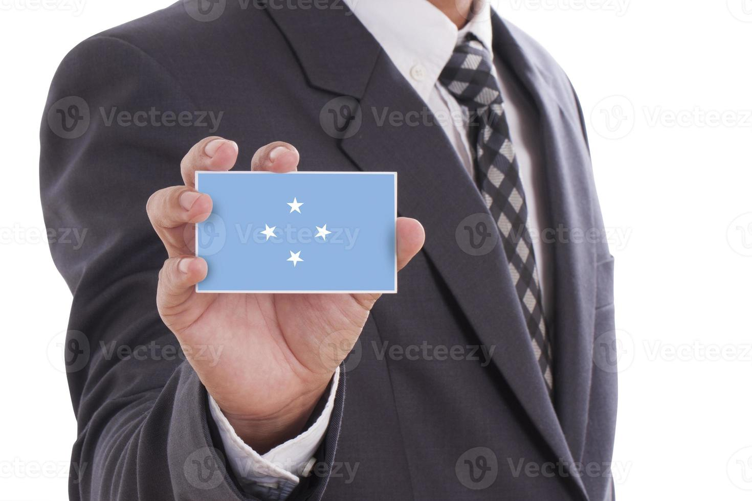 Businessman holding Micronesia Flag photo