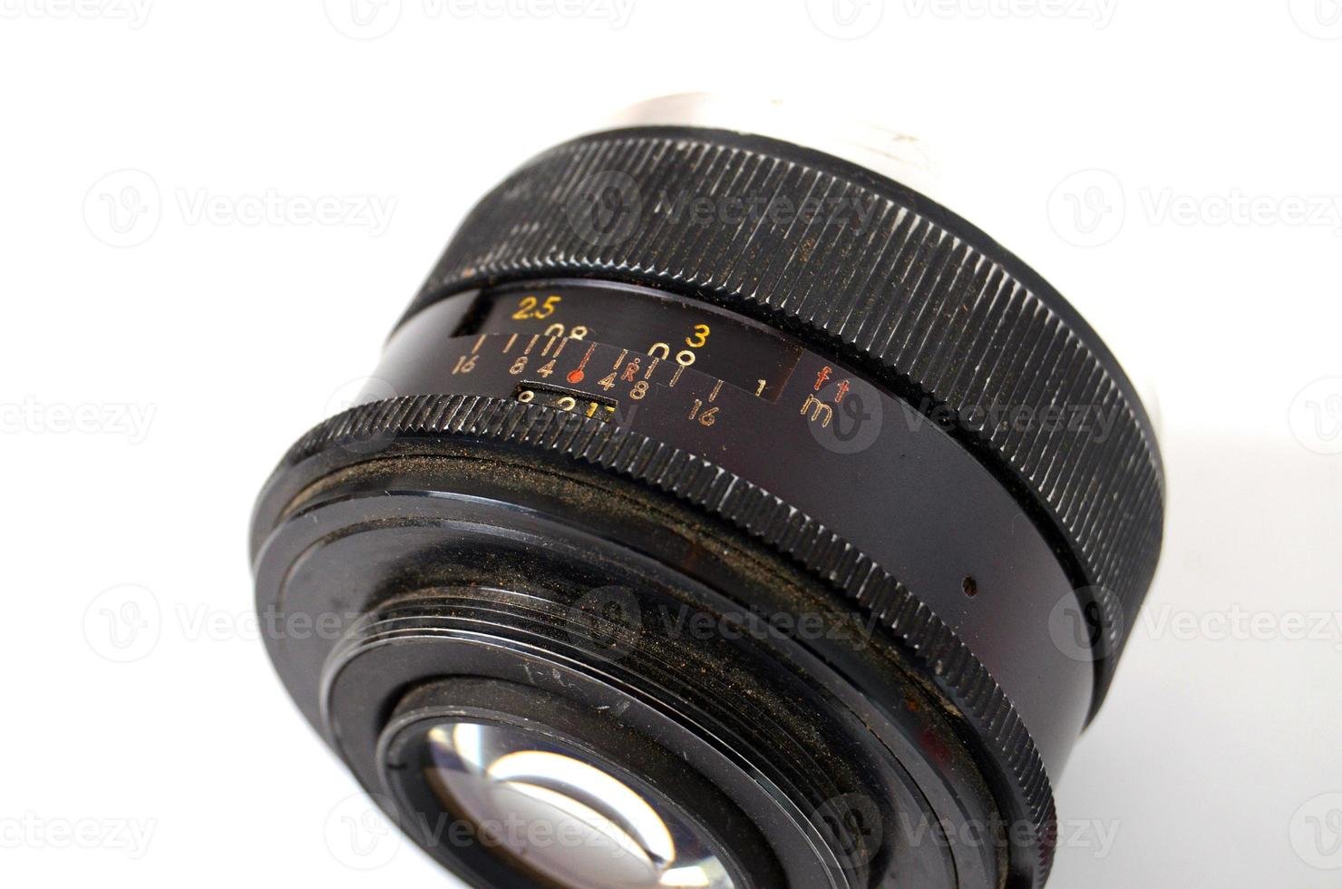 An Old Manual Control Camera Lens Isolated On White photo