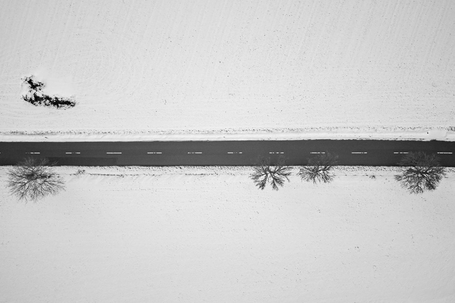 Top-down view of a road in the middle of snow photo