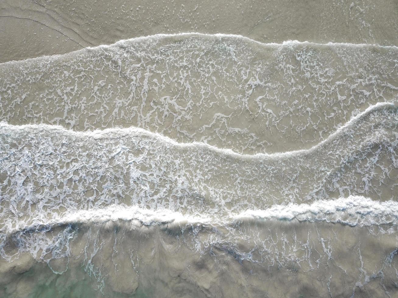Ocean waves crashing to shore photo