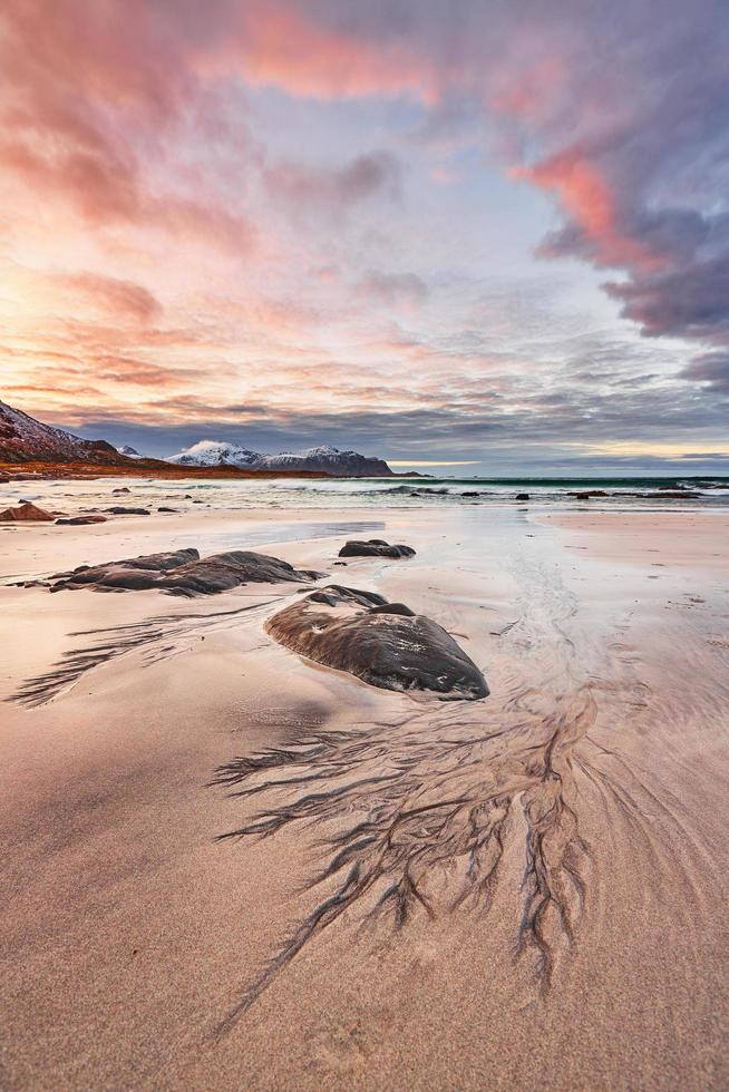 Brown rock on a sandy beach photo