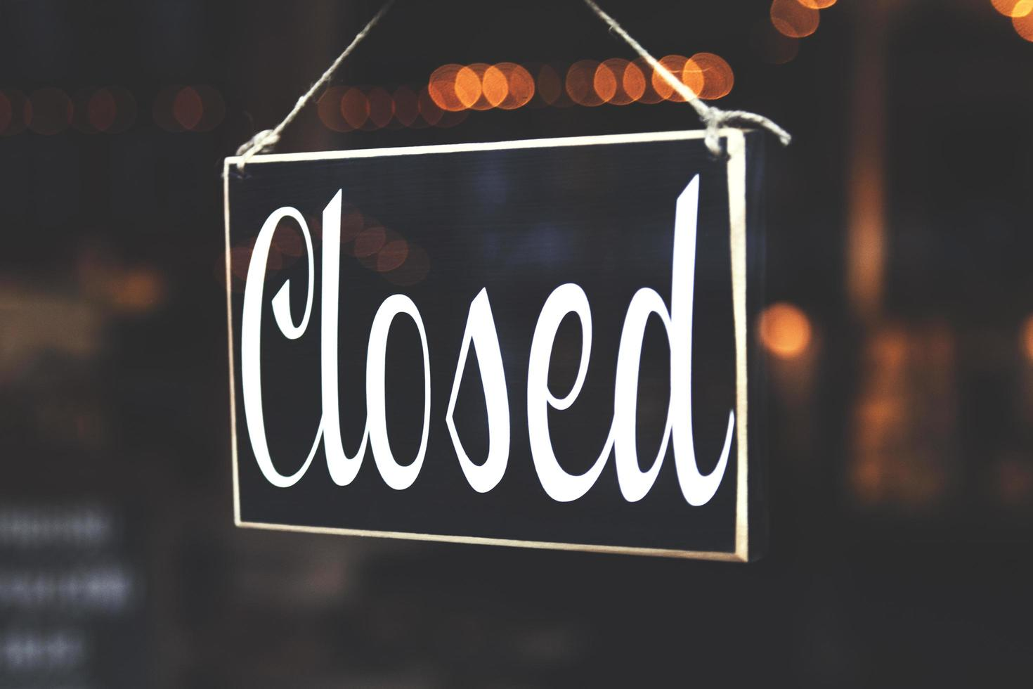 Closed sign in business window photo