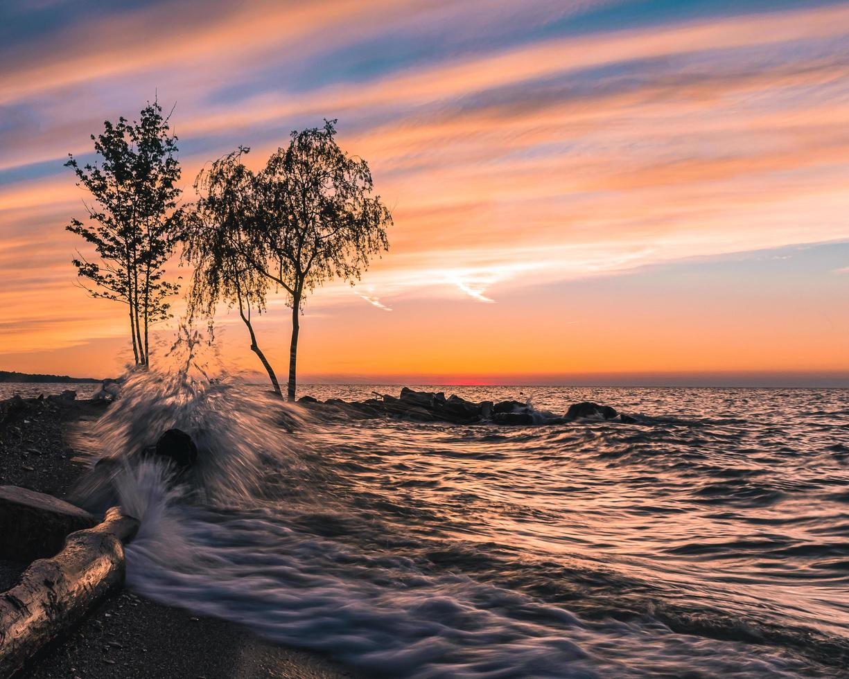 Waves crashing on the shore photo