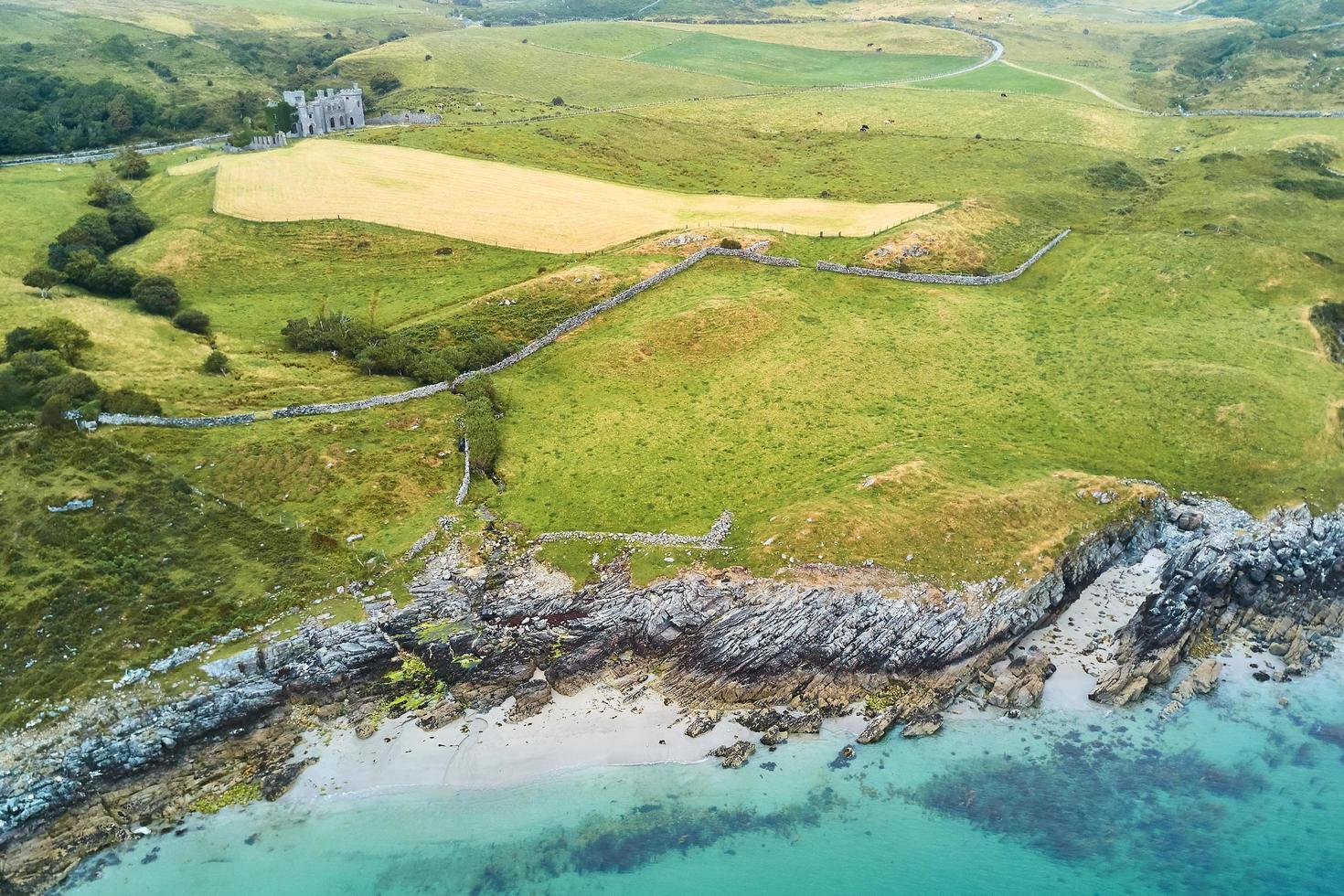 Aerial view of green grass field promontory photo