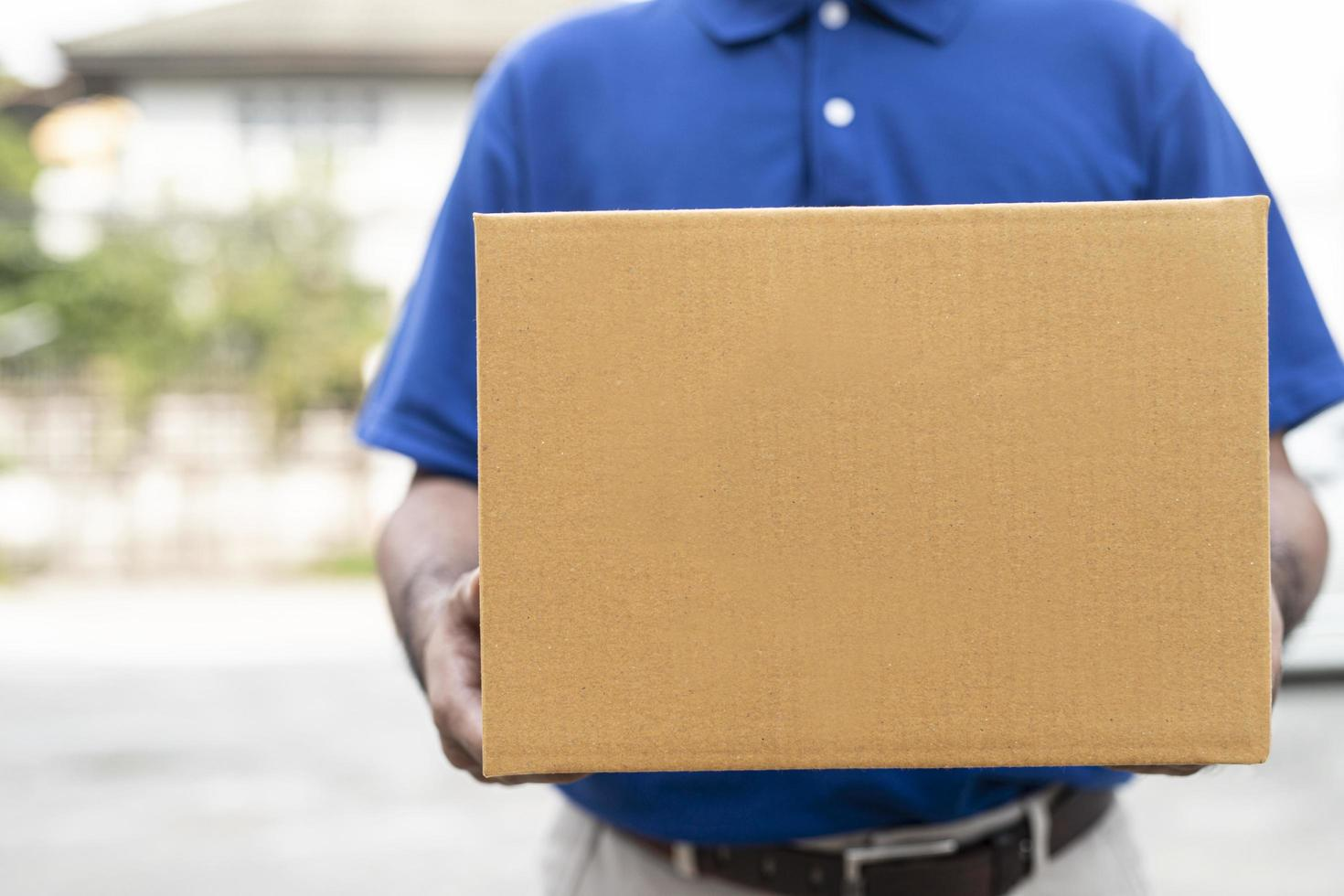 Delivery man holding box photo