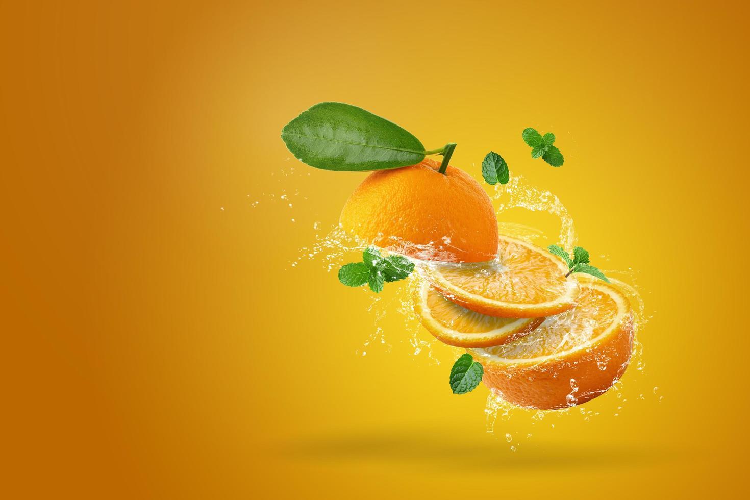 Water splashing on fresh sliced orange  photo