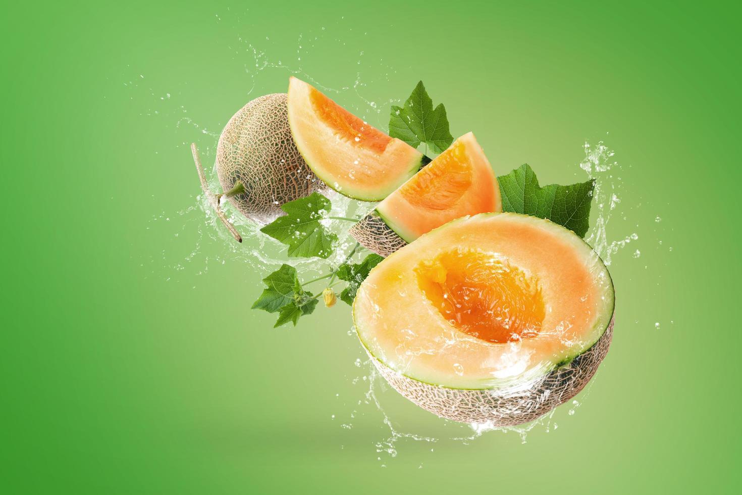 Water splashing on Japanese melons photo