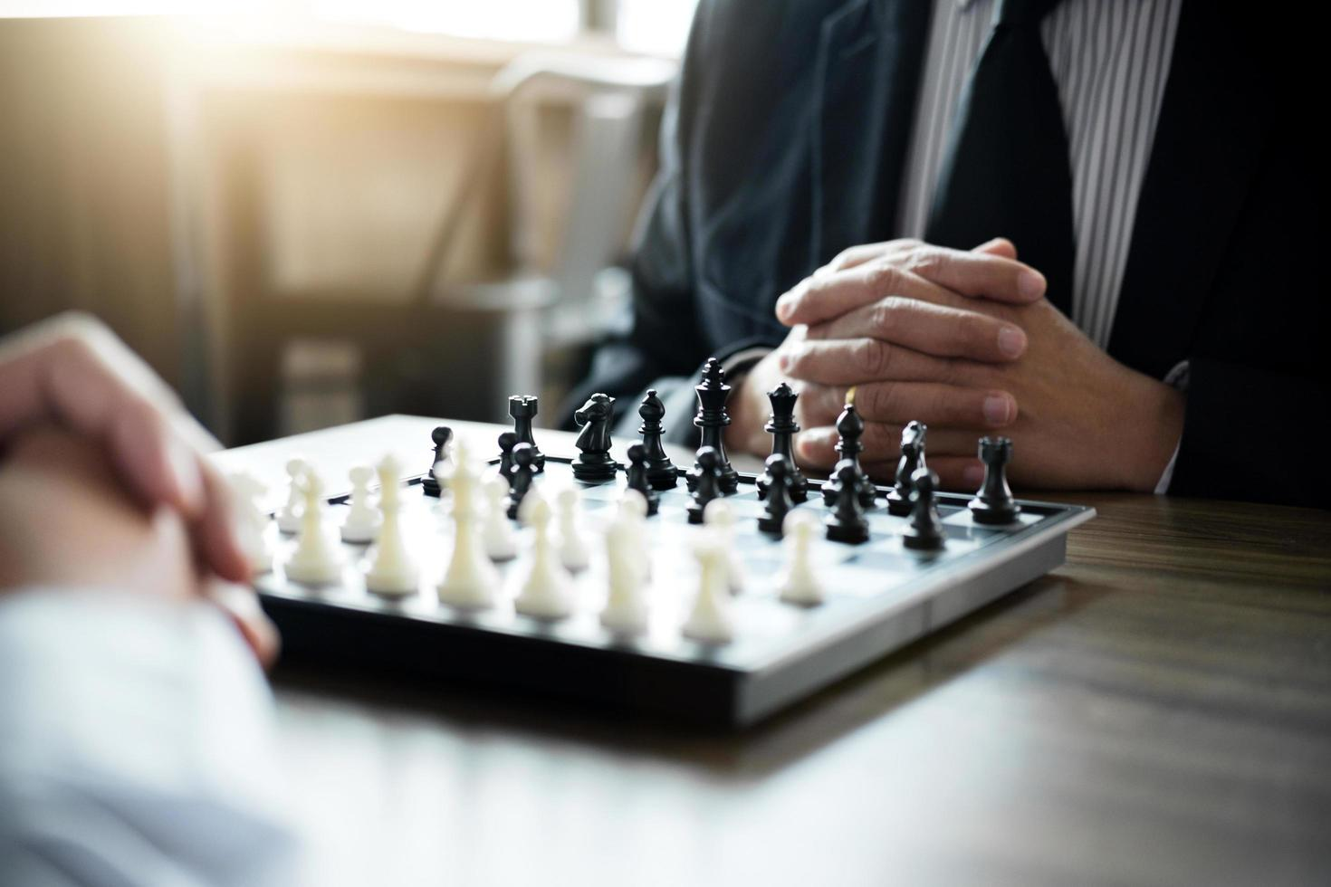 Colleagues playing chess game  photo