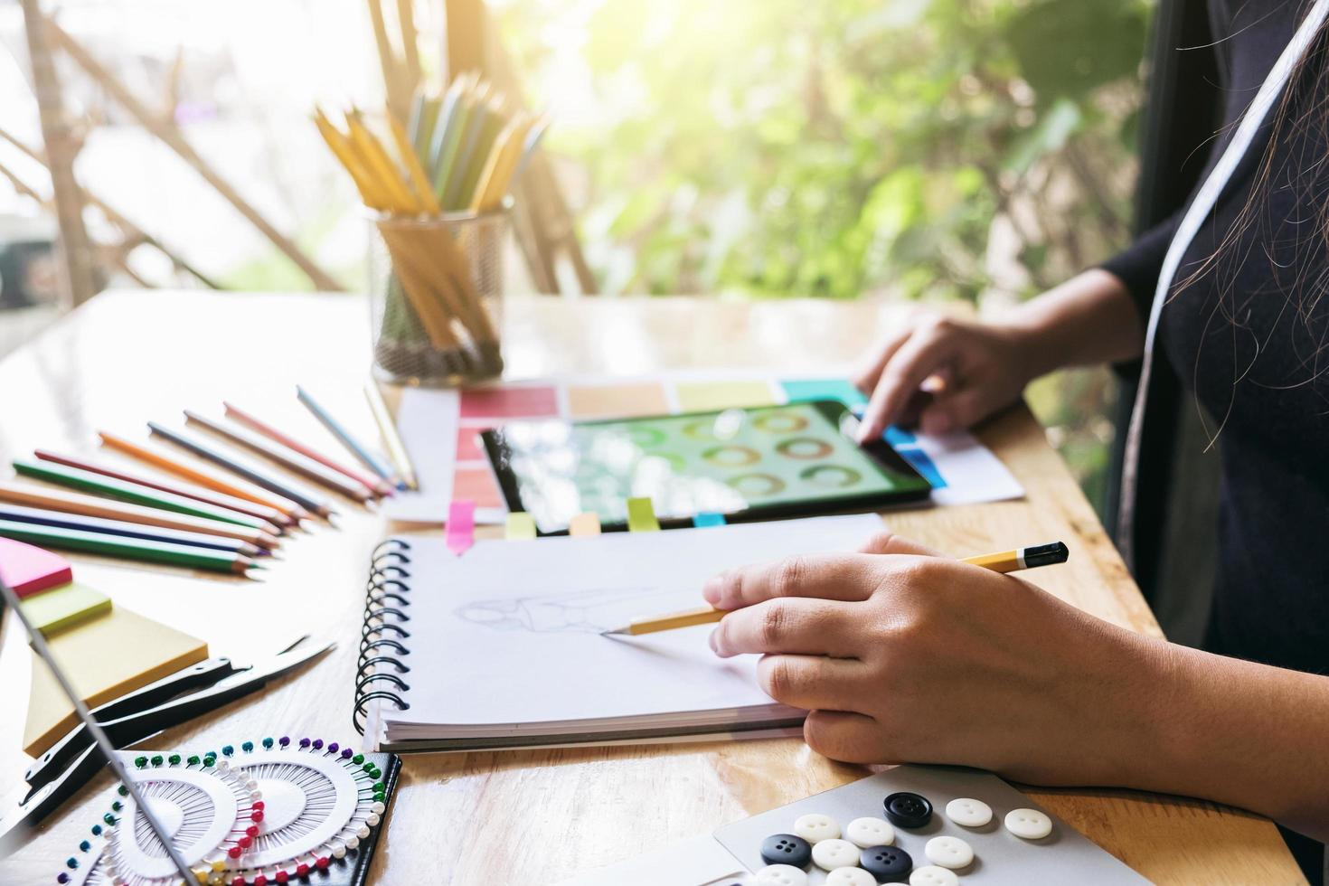 Young designer working as fashion sketches  photo