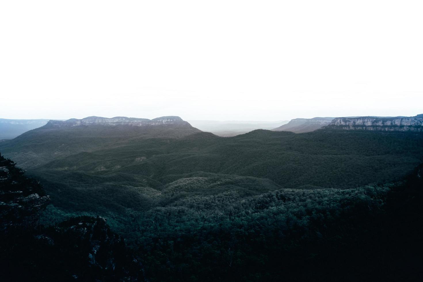 Green mountains under white sky  photo