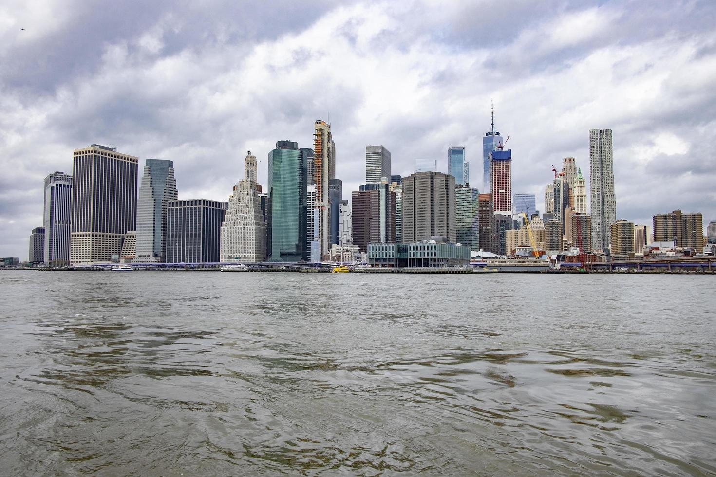 New York City skyline under cloudy sky photo