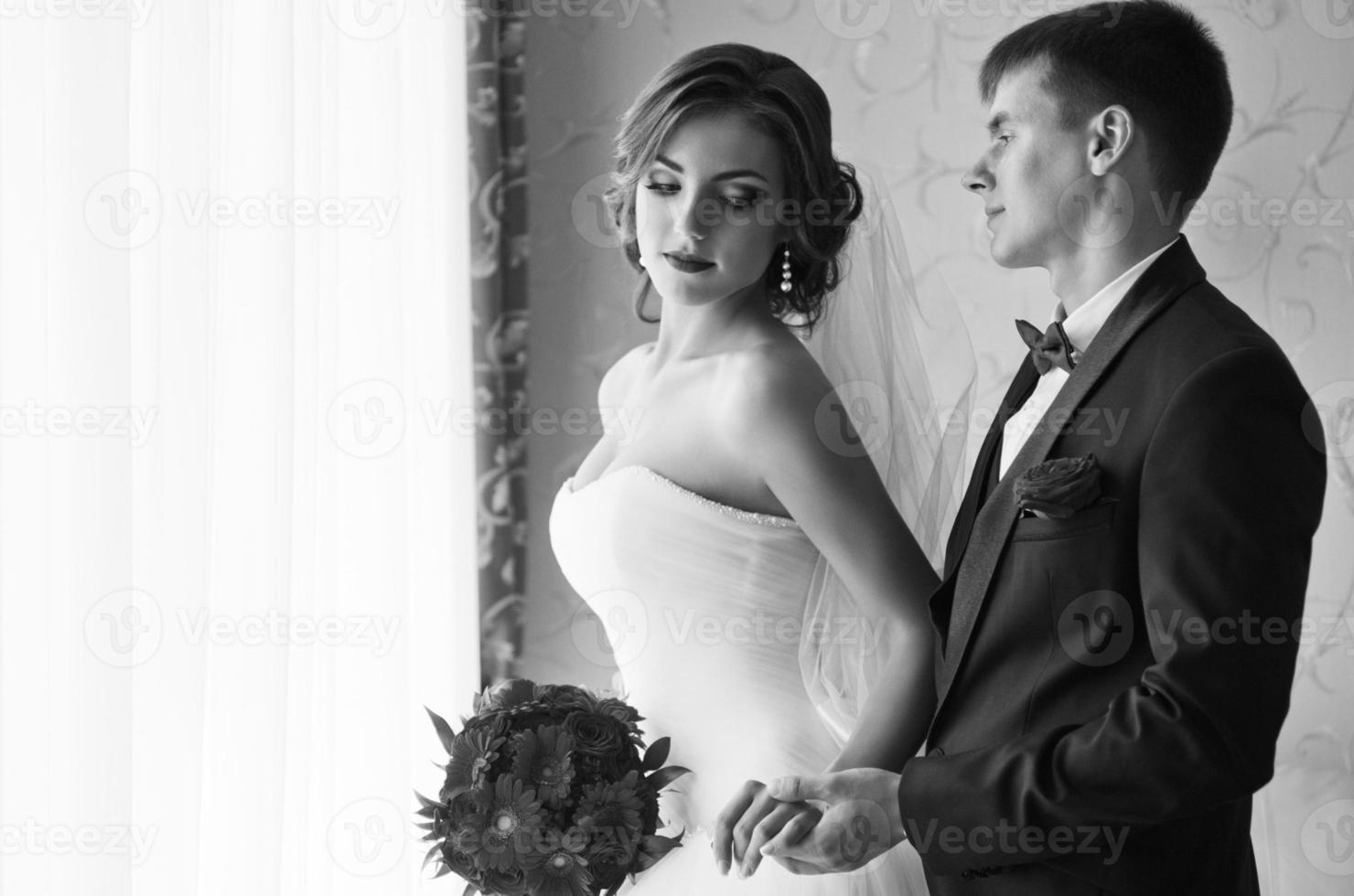 Couple in the room (monochrome) photo