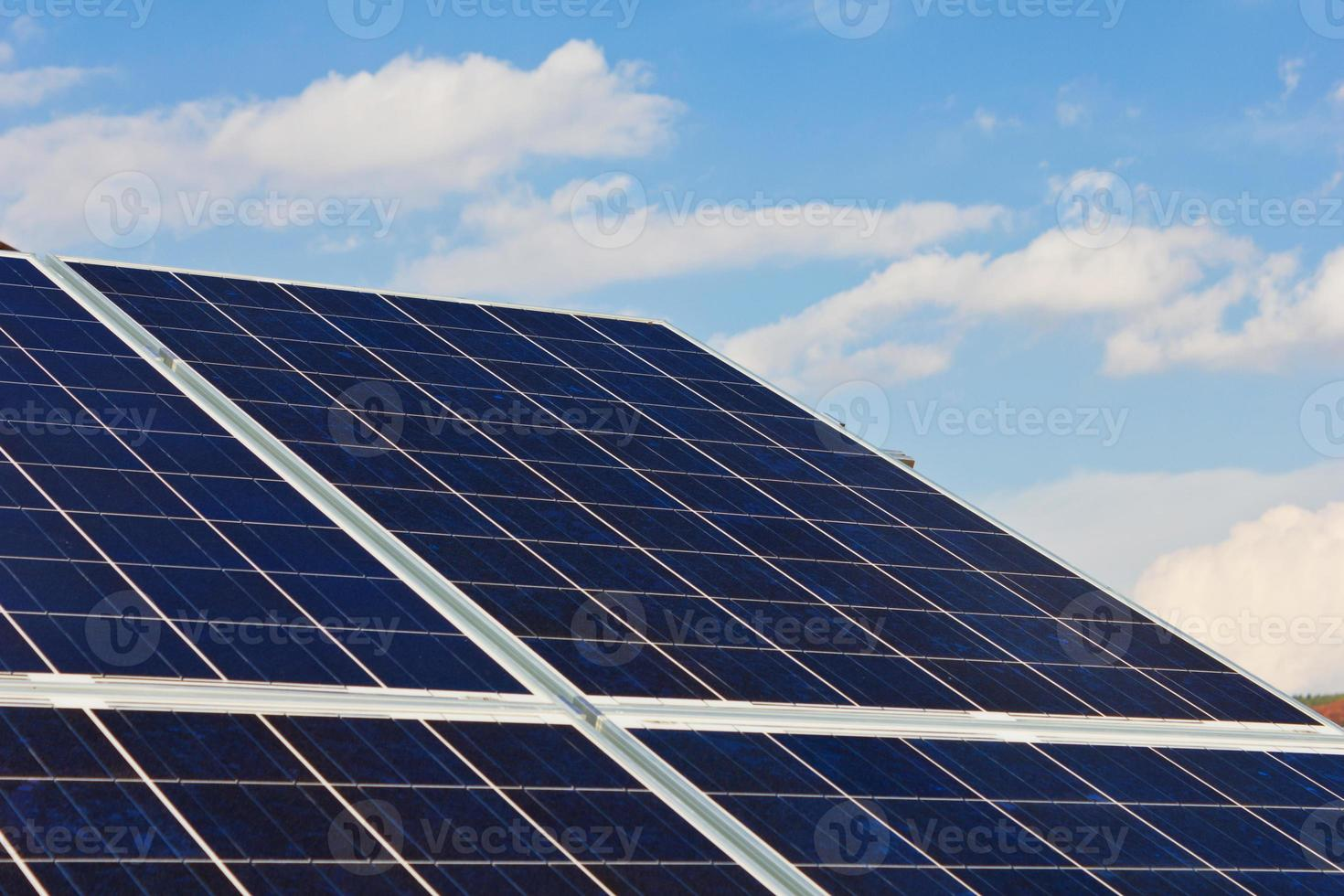 Roof with solar panels cells photo