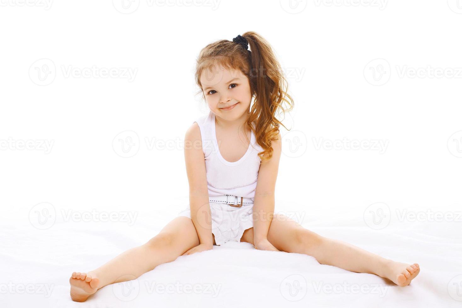 Portrait of happy little girl child having fun photo